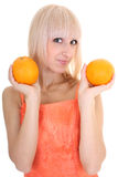 Young attractive woman with two oranges Stock Photo