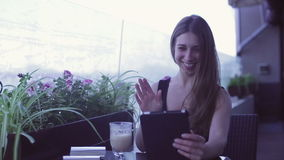 Young attractive woman using laptop while sitting in cafe. Young attractive woman using laptop while sitting in street cafe stock video footage