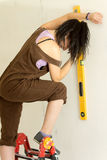 Young attractive woman using spirit level stock photo