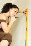 Young attractive woman using spirit level stock photography