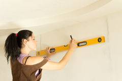 Young attractive woman using spirit level royalty free stock photo