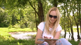 Young attractive woman using tablet stock video