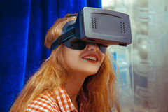 Young attractive woman in virtual reality helmet Stock Image