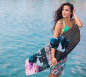 Young attractive woman with wakeboard Stock Image