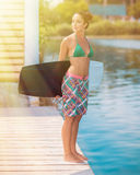 Young attractive woman with wakeboard Stock Photo