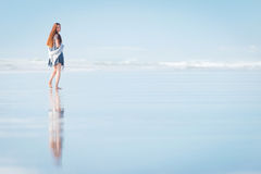 Young attractive woman walking at amazing New Zealand beach Stock Image