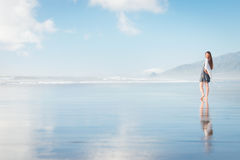 Young attractive woman walking at amazing New Zealand beach Stock Photos
