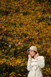 Attractive woman in evening autumn park Stock Photos