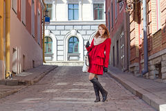 Young attractive woman walking in old town of Tallinn Stock Photo