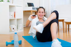 Young attractive woman watching sport exercises on tv Stock Images