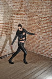 Young attractive woman wear leather clothes in retro house Stock Photography