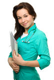 Young attractive woman wearing a doctor uniform Royalty Free Stock Images