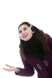 Young attractive woman wearing ear muffs Royalty Free Stock Images
