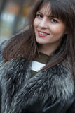 Young attractive woman wearing fur, autmn outside Stock Photos