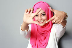 Young attractive woman wearing scarf smiling Stock Photography
