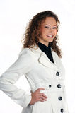 Young attractive woman wearing a white jacket. Smiling young woman isolated on a white studio background Stock Photo