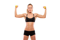Young attractive woman with weights Royalty Free Stock Image