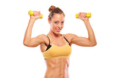 Young attractive woman with weights Royalty Free Stock Photo