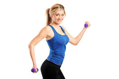 Young attractive woman with weights Royalty Free Stock Photos