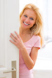 Young attractive woman welcoming you in her house Stock Photography