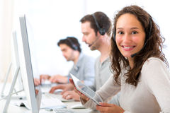 Young attractive woman working in a call center Stock Photo