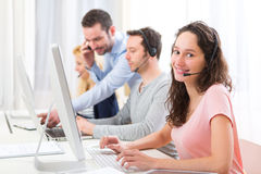 Young attractive woman working in a call center Royalty Free Stock Photo