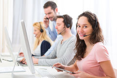 Young attractive woman working in a call center Royalty Free Stock Images