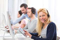 Young attractive woman working in a call center Stock Photos