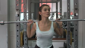 Young attractive woman working hard in the gym. stock video footage