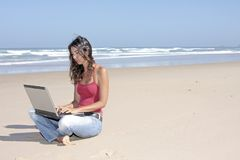 Young attractive woman working on her laptop Stock Image