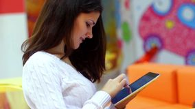 Young attractive woman working with her tablet stock footage