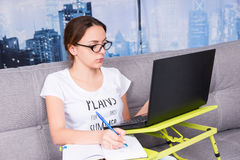 Young attractive woman working on a laptop from home Stock Image