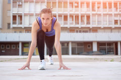 Young attractive woman working out outdoor Royalty Free Stock Image