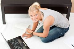 Young attractive woman works on her laptop Stock Images