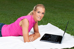 Young attractive woman works on her laptop Stock Photo