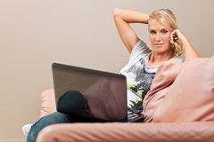 Young attractive woman works on her laptop Stock Photography