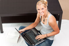 Young Attractive Woman Works On Her Laptop Royalty Free Stock Photos