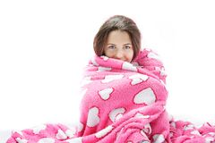 Young attractive woman wrapped in pink blanket Stock Photos