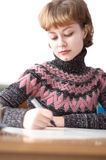 Young attractive woman writing Royalty Free Stock Image