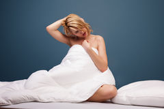 Young attractive woman yawning in bed Royalty Free Stock Photo