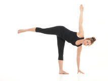 Young attractive woman in yoga pose Royalty Free Stock Image