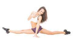 Young attractive women showing her flexibility Royalty Free Stock Images