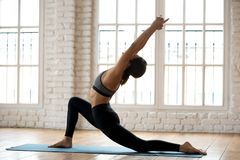 Young attractive yogi woman practicing yoga, doing anjaneyasana. Young attractive yogi woman practicing yoga, doing Horse rider exercise, anjaneyasana pose stock images