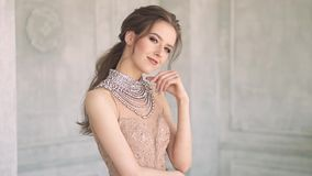 Young attractive young girl in evening dress with festive make-up and hairstyle stock footage