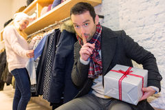 Young attrative man preparing gift surprise. View of a Young attrative man preparing gift surprise Stock Photography