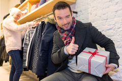 Young attrative man preparing gift surprise Royalty Free Stock Photo
