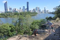 Young Australian man abseiling from a cliff in Brisbane Australia. Young Australian man abseiling from a cliff in Kangaroo point in Brisbane Queensland royalty free stock photos