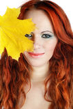Young autumn woman with yellow leaf Royalty Free Stock Photo