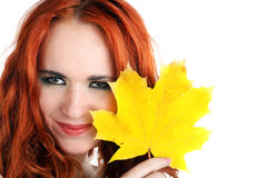 Young autumn woman with yellow leaf Stock Image
