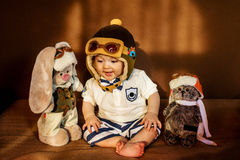 Young aviator and his friends. Royalty Free Stock Images